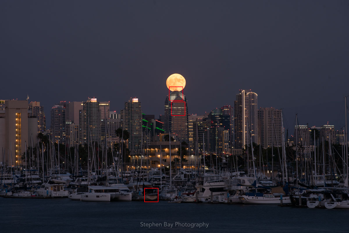 Full moon over skyscrappers.