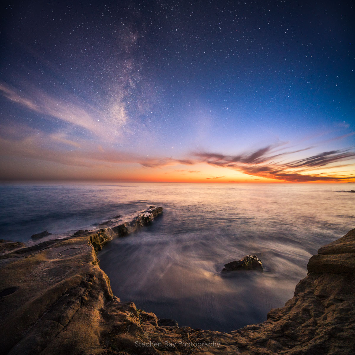 This photo has both the milky way core in the sky and the colors from sunset. The foreground shows the rocks along the La Jolla coast.